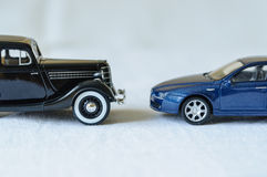 Two generations of cars Stock Photos