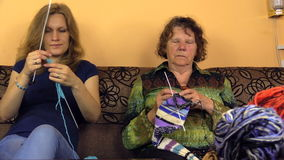 Two generations nice spend free time knitting room, focus change stock video