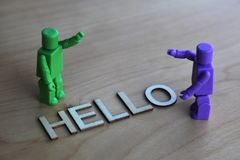 Two generic figures saying hello to each other Stock Image