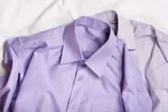 Two generic shirt with a line pattern, closeup Stock Photos
