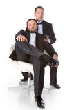 Two gentleman. In a black tuxedo with a white background isolated Royalty Free Stock Photography
