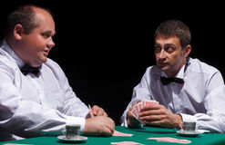 Two gentlemen in white shirts, playing cards Royalty Free Stock Photography