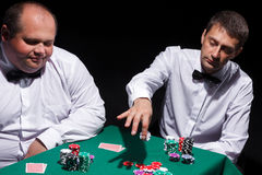 Two gentlemen in white shirts, playing cards Royalty Free Stock Images