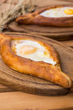 Two Georgian khachapuri close-up on the table.  Royalty Free Stock Photo
