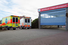 Two german ambulance vehicles stands on hospital Royalty Free Stock Images