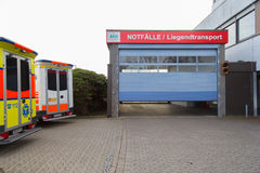 Two german ambulance vehicles stands on hospital Royalty Free Stock Image