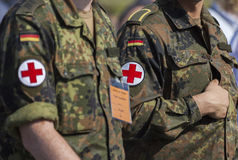 two german army soldiers with a red cross brassard Stock Images