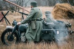 Free Two German Soldiers Of The Wehrmacht On A Motorcycle Stock Image - 126498721