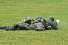 Two germans with machine gun. Two germans lying with machine gun royalty free stock photo