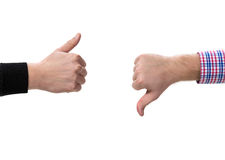 Two gesturing hands. With thumbs up and down Stock Photo