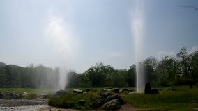Two geysers from Sun Kam Pang Hotspring. Chiang Mai, Thailand, under the blue sky stock footage