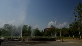 Two geysers under blue sky stock video footage