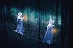 Two ghosts in a dark forest. Royalty Free Stock Photography