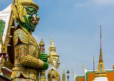 Two giant demon guarding an exit in Wat Phra Kaew, Bangkok. Royalty Free Stock Photography