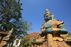 Two giant guardians stand in front of Thai temple Royalty Free Stock Photo