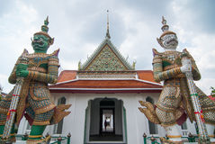 Two giant guardians of Wat Arun Stock Images