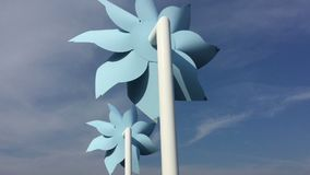 Two giant pinwheel rotating stock footage