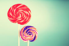 Two giant spiral lollipops on blue pastel background Stock Images