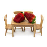 Two giant strawberries on the dining table Royalty Free Stock Image