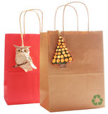 Two gift bags made of recycled paper, Natural. Two gift bags made of recycled paper, decorated with natural wood bio degradable ornaments Stock Image