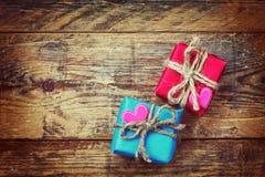 Two gift box, heart sticker Stock Photos