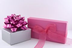 Two gift boxes. One silver and one pink Stock Photo