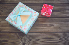 Two gift boxes blue and pink on a wooden background. horizontal Royalty Free Stock Photography