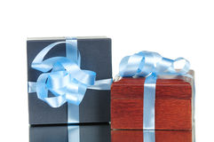 Two gift boxes with blue ribbon isolated Stock Photos