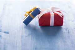 Two gift boxes on blue table Royalty Free Stock Photos