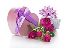 Two gift boxes with bouquet of beautiful rose Royalty Free Stock Photo