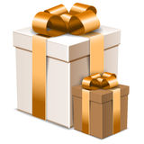 Two gift boxes with decorative golden bows isolated on white Royalty Free Stock Photos