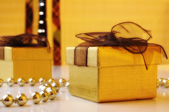 Two gift boxes. With golden pearls and yellow background Royalty Free Stock Photos
