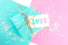 Two gift boxes of pink and blue. Gift tag with the inscription love. royalty free stock photo