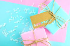 Two gift boxes of pink and blue. royalty free stock image