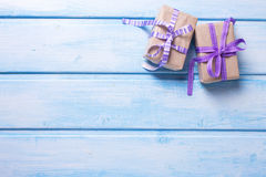 Two gift boxes with presents on blue painted  wooden background. Royalty Free Stock Image