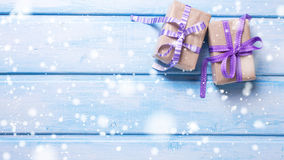 Two gift boxes with presents on blue painted  wooden background. Royalty Free Stock Photo