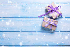 Two gift boxes with presents on blue wooden background. Stock Images