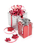 Two gift boxes with ribbons and christmas decor Stock Photos