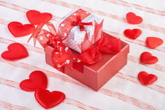 Two gift boxes surrounded by soft hearts Stock Photos