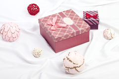 Two gift boxes on white satin background Stock Images