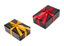 Two gift boxes with yellow and red satin ribbon Stock Image