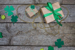 Two gift in kraft paper and clover leaves. Patricks Day Royalty Free Stock Photo