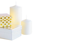 Two gift small boxes and candles on white background Royalty Free Stock Images