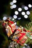 Two gifts in a christmas tree Royalty Free Stock Photo