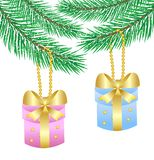Two gifts hang on a christmas tree Stock Images