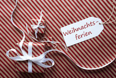 Two Gifts With Label, Weihnachtsferien Means Christmas Break Stock Image