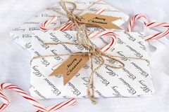 Two Gifts with Merry Christmas Tags and Candy Canes stock image