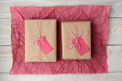 Two Gifts on Red Tissue Paper Stock Image