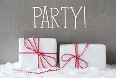 Two Gifts With Snow, Text Party. English Text Party. Two White Christmas Gifts Or Presents On Snow. Cement Wall As Background. Modern And Urban Style. Card For Stock Image