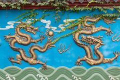 Two-Gilding dragon wall. Dragon Wall is a unique form of architecture in China. It has a dragon wall, three dragon walls, five dragon walls, seven dragon walls royalty free stock photo